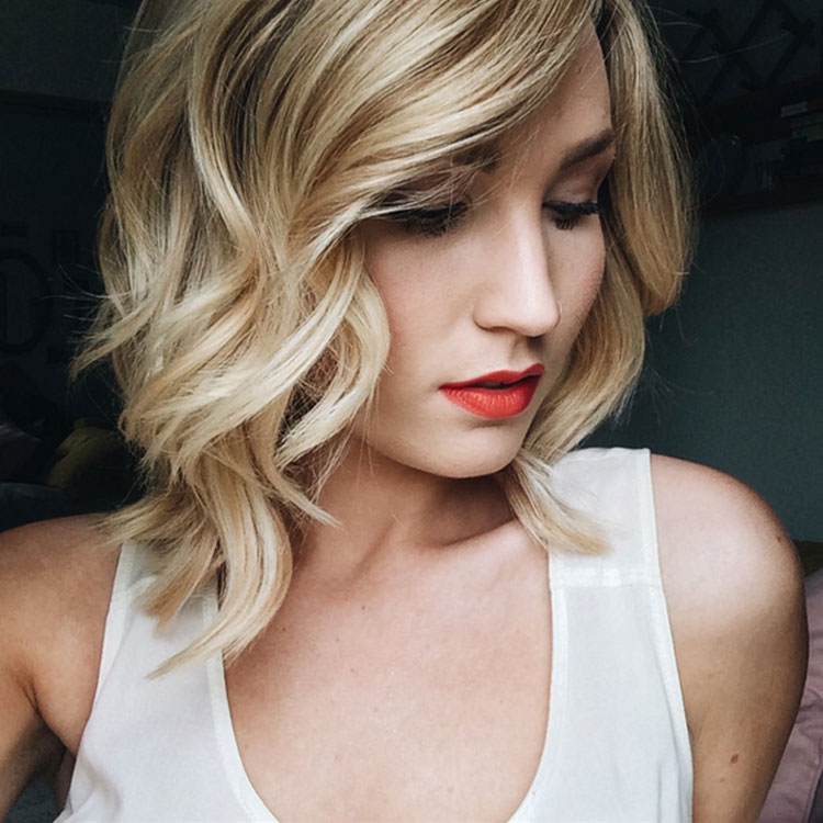 Bob Hairstyle With Outward Curls And Soft Fringes