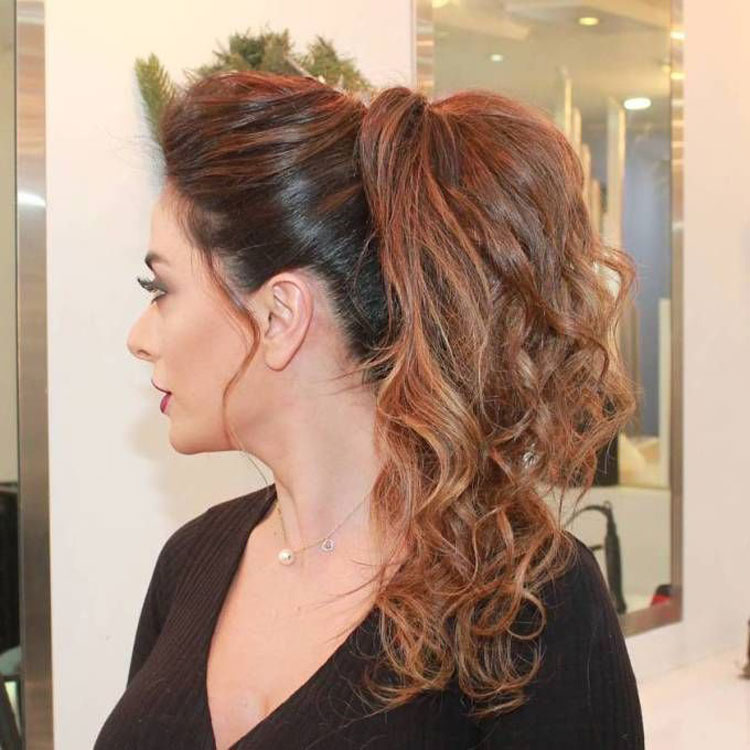 Wavy Ponytail On The Side With A Side Bang